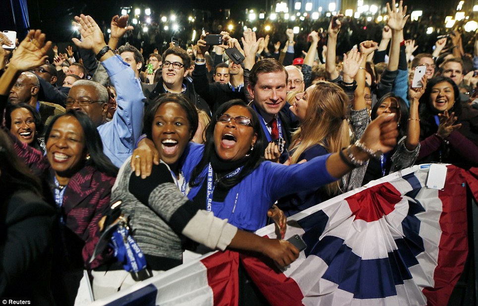 Kisses all round: US President Barack Obama supporters cheer during his victory election night rally in Chicago