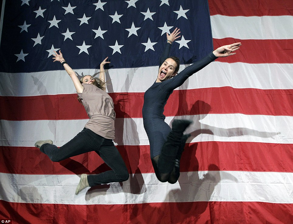 Jumping up: Supporters of President Barack Obama - Shauna Harry, left, and Alana Hearn - celebrate by leaping in the air at New York State Democratic Headquarters