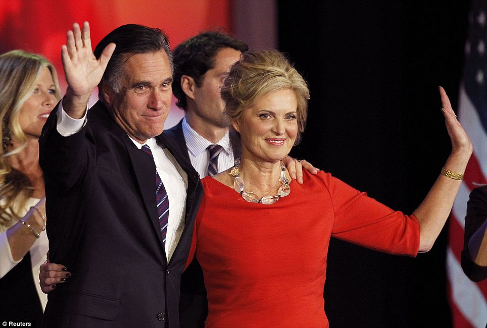 Defeated: Mitt Romney stands on stage with his wife Ann during his election night rally in Boston
