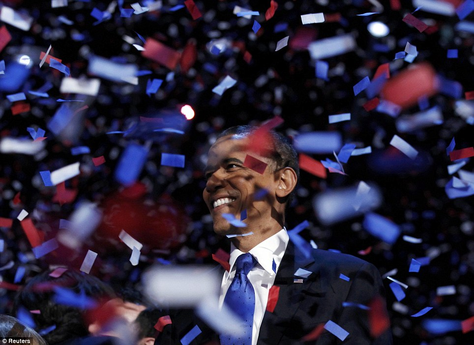 Happy man: US President Barack Obama celebrates on stage as confetti falls after his victory speech during his election rally in Chicago on Tuesday night