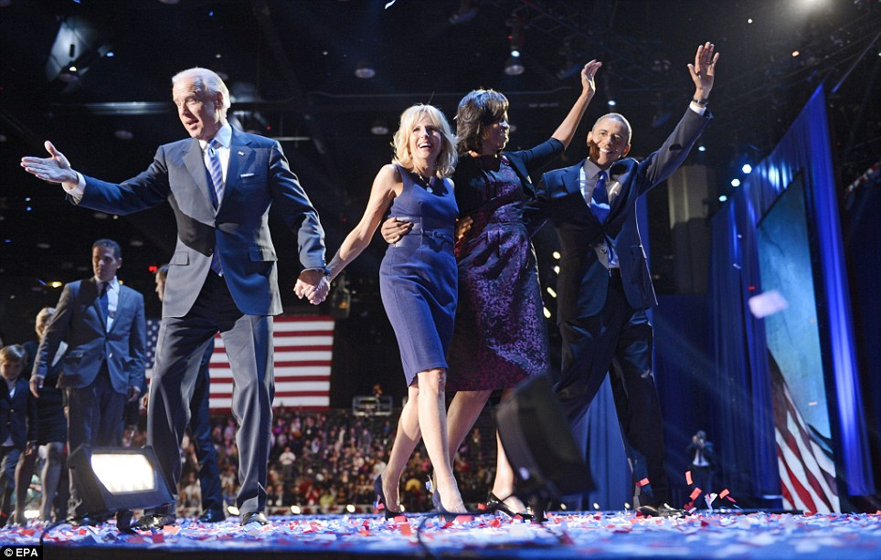 All together: US President Barack Obama and his wife Michelle celebrate onstage with Vice President Joe Biden and his wife Jill Biden at McCormick Place in Chicago