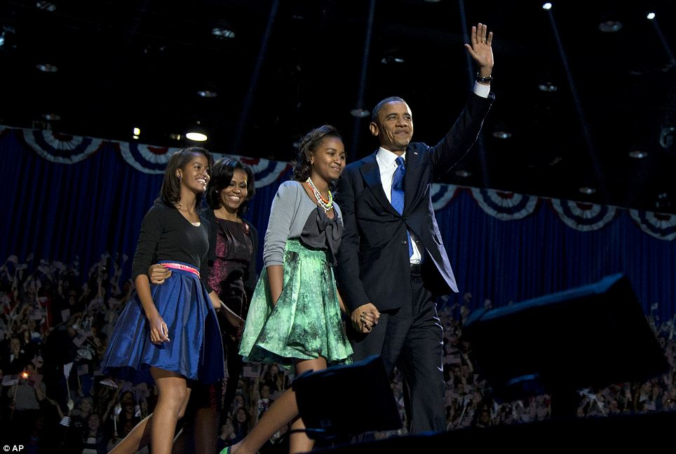 President Barack Obama, accompanied by first lady Michelle Obama and daughters Malia and Sasha arrive at the election night party in Chicago