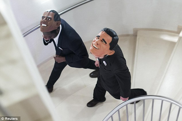 Race to the White House: Guests at the Bertelsmann media co-operation in Berlin wear Obama and Romney masks