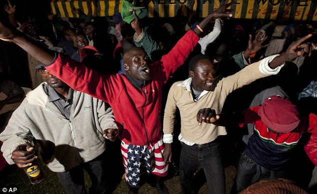 We've done it! Villagers dance through the night in the Obama ancestral village of Kogelo