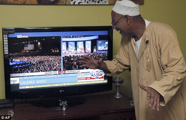 World vision: A Kenyan supporter of Obama watches his victory speech on a television news channel