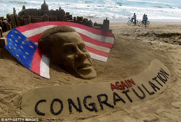 Impressive: This sand-sculpture celebrated Obama's re-election on Puri beach in the east of India. It was the inspired creation of sand artist Sudarshan Pattnaik