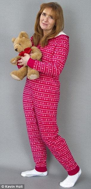 Cosy: Angela loves sleeping in her onesie - even though it's made her the butt of her husband's jokes