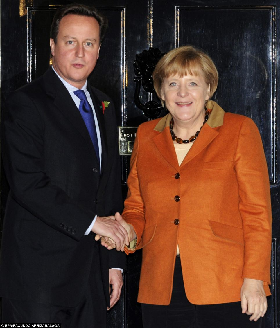 'Alone they would not be happy in this world': Angela Merkel made the comments ahead of dinner with David Cameron at Downing Street tonight