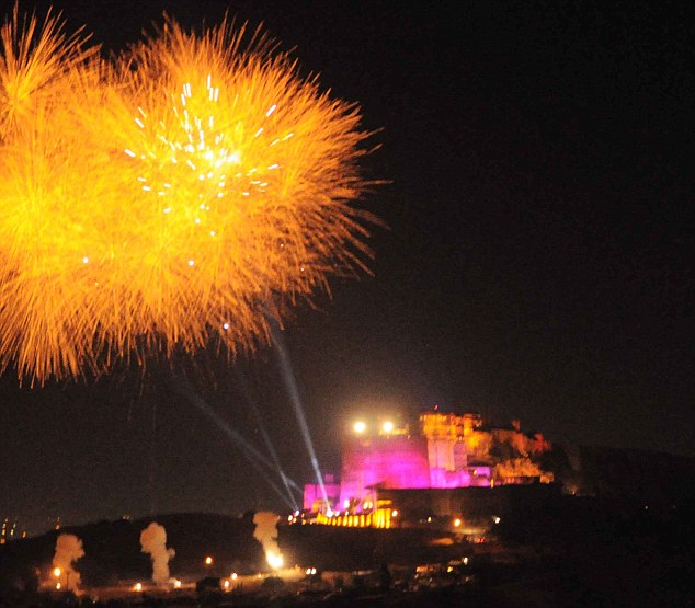 Lavish: Fireworks light up the sky above Mehrangarh Fort - but these got the party manager in trouble with locals and the police