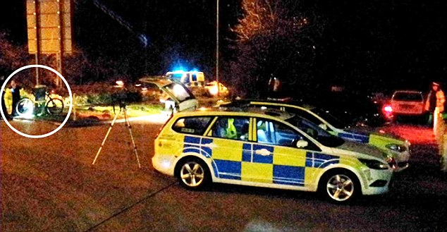 The scene last night where cyclist Bradley Wiggins collided with a White Astra van as the van pulled away from the forecourt.