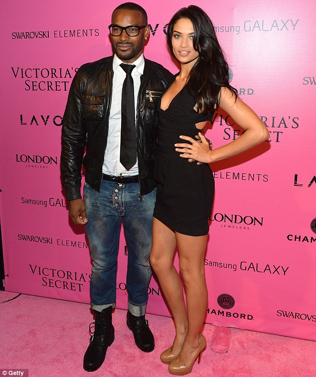 Lucky boy: But even gliding down the carpet with Shanina Shaik was not enough to make Tyson Beckford smile