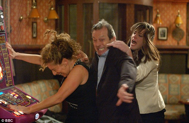 Fight: Dirty Den is pictured (centre) in an episode of EastEnders in 2005 with his second wife Chrissie Watts (left) and Zoe Slater (right), with whom he had an affair