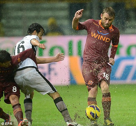 Blue future? Mancini is keen to land Italy and Roma midfielder Daniele De Rossi (right) in January