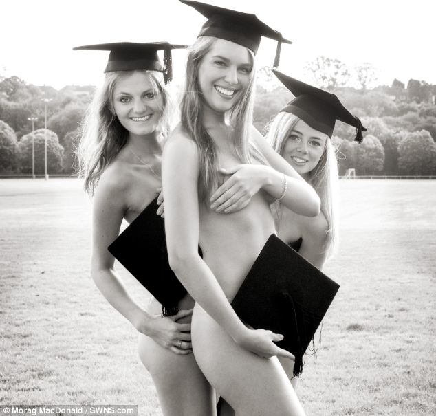 Naked ambition: The girls celebrate the end of term wearing just mortarboards in the July photo
