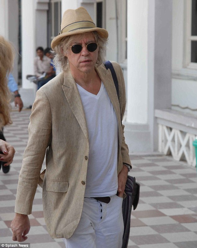 On his way: Bob Geldof also covered his eyes with sunglasses as he recovered from the excitement the night before