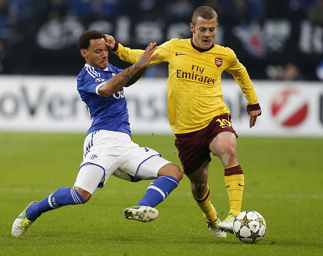 On the comeback trail: Jack Wilshere (right) in action for Arsenal on Tuesday
