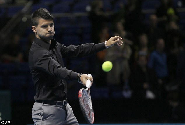 Stick to the day job: Aguero looked far less at ease with a racket in his hand than he does with a football at this feet