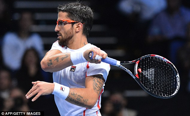 Easy does it: Del Potro brushed aside Tipsarevic (below) in no time