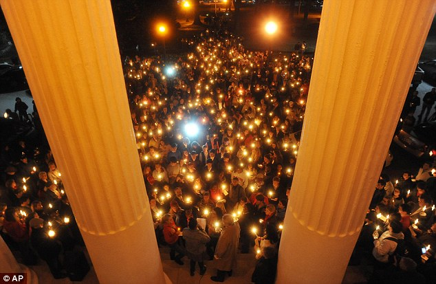 Vigil: A crowd participates in a candlelit vigil titled 'We Are One Mississippi' at Ole Miss Wednesday night in response to the Election Day protests