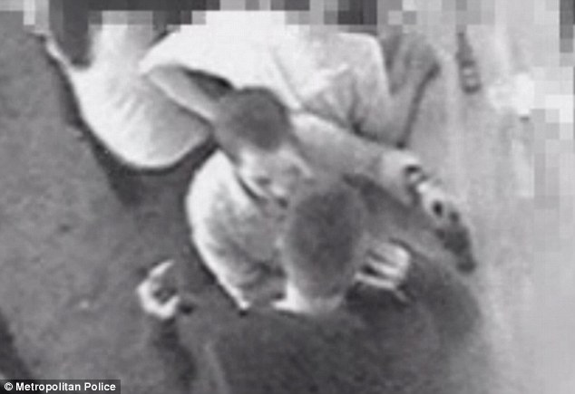 How it happened: Ashley Charles (in white) can be seen squaring up to Phillip Sherriff at the bar. The victim can be seen holding a beer bottle and talking on his mobile phone