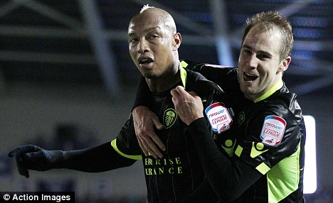 El of a signing: El Hadji Diouf (left) celebrates with Luke Varney after scoring the first goal for Leeds from the penalty spot at Brighton last week