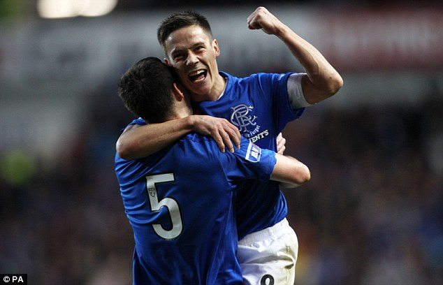 Doubled up: Ranger's Lee Wallace celebrates the second goal with Black