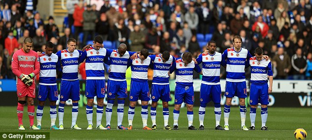 Respect: Reading players observe a minutes' silence before their game against Norwich