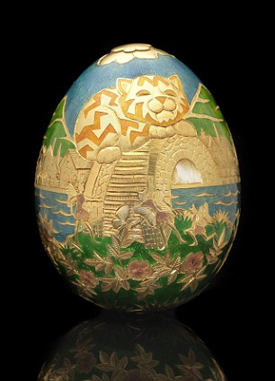 The 22 carat gold egg is inscribed with various carvings depicting the location it was hidden on the Isle of Man