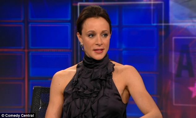 Confident: Paula Broadwell appeared on The Daily Show with John Stewart in January to promote her biography of David Petraeus 'All In'