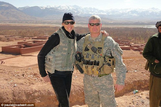 Devoted: Broadwell, pictured with Lt Col. Steve Grenier in Gizab, also writes opinion pieces on leadership