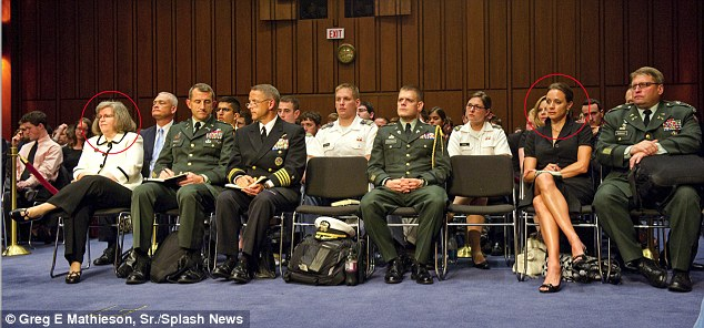 Just Feet Apart: Holly Petraeus (left in white) and Paula Broadwell sit in the front row during the CIAconfirmation hearing of US Army General David Petraeus