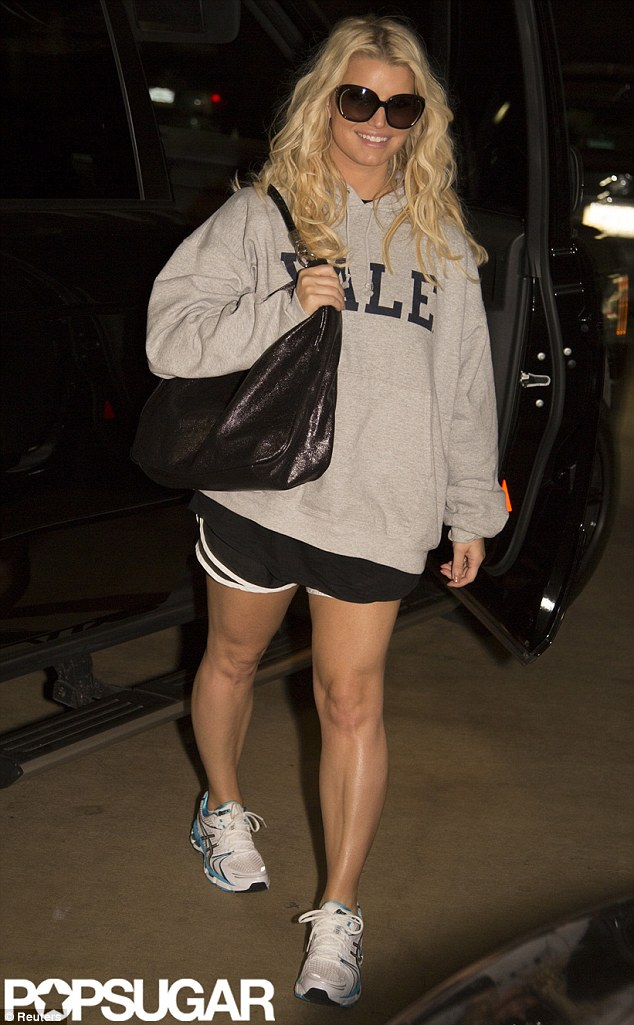 Grinning and winning: The singer is photographed at the end of last month heading to a late night workout in a picture by Popsugar