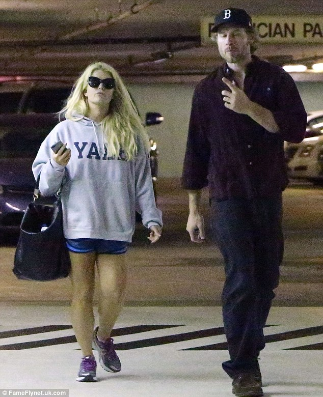 Defiant: Jessica Simpson wore tiny shorts as she stepped out with her fiance Eric Johnson on Friday