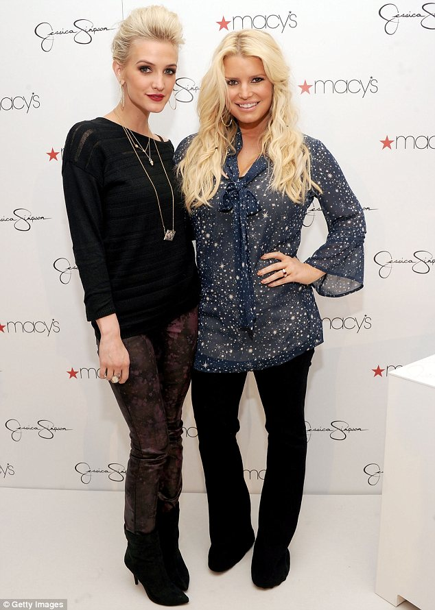 Sisters-in-arms: Jessica and Ashley Simpson were seen for the first time since rumours of their dad being gay emerged at an autograph signing for their clothing line at Macy's in Costa Mesa, California