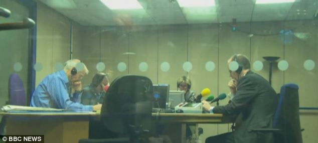 Stand off: John Humphrys (left) grills George Entwistle (right) on air and questions him, 'you should go, shouldn't you?'