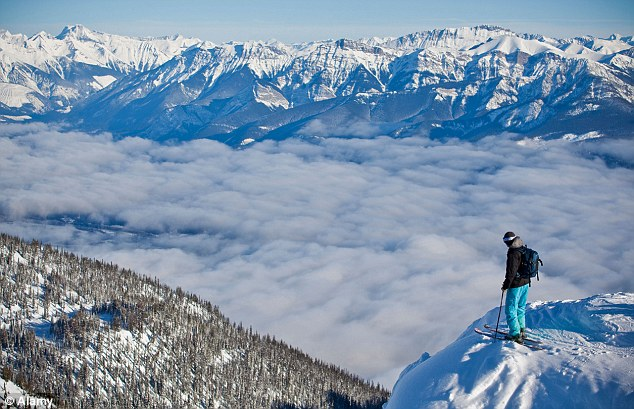 A skier enjoys the views at Kicking Horse Resort