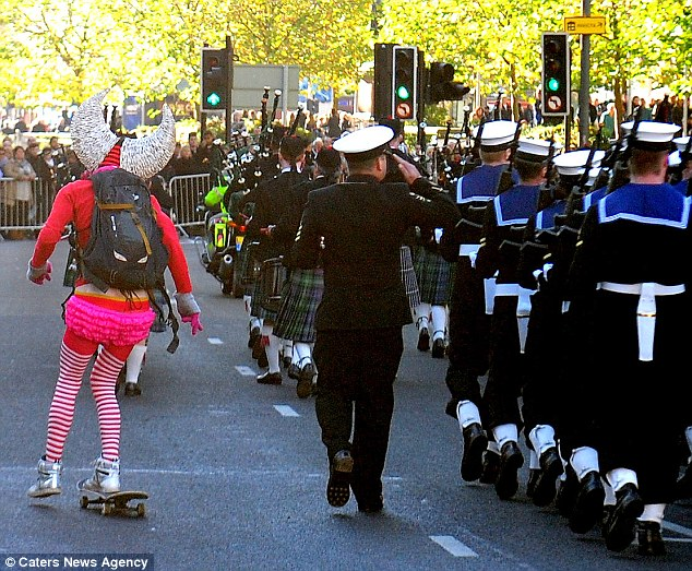 Affront: Horrified onlookers shouted at the bearded man as he disrupted the city's Remembrance Sunday parade today