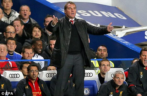 Hands on: Rodgers gives out his instructions from the touchline at Stamford Bridge