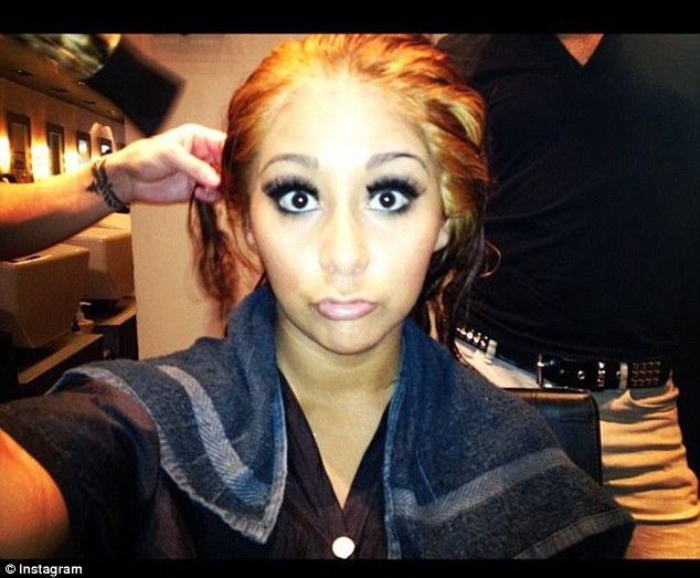 Uh oh!: Snooki looks concerned by her orange hair