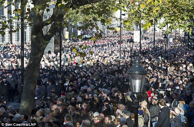 Huge crowds: Members of the public and servicemen filled Whitehall for yesterday's ceremony