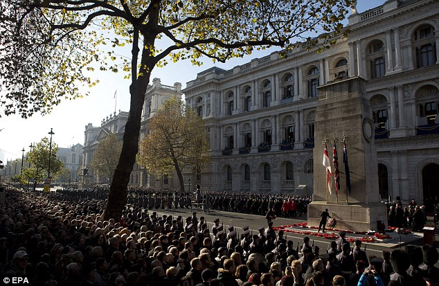 Pride: Wreaths were laid as British war veterans marched past the Cenotaph during yesterday's ceremony