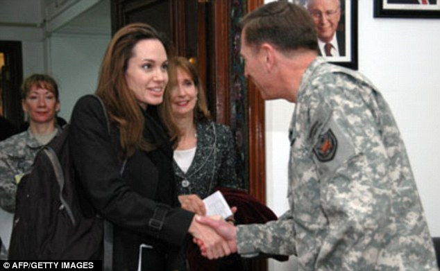 Security no-no: Petraeus passed on an unofficial photograph to Broadwell of him meeting with actress Angelina Jolie at the CIA, breaking with agency protocol