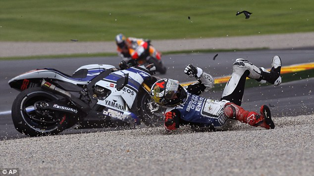 On the slide: Lorenzo careers across the tarmac and finally comes to a halt in the gravel