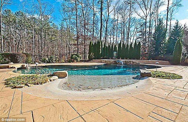 Water feature: The back garden is equip with a large outdoor swimming pool
