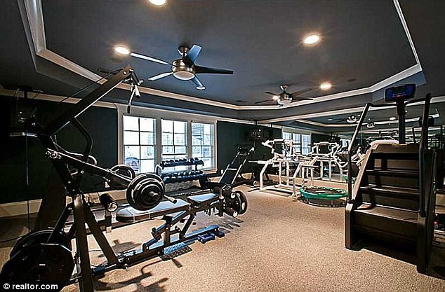 How he kept the six pack intact: The Atlanta abode also has an indoor gym with various exercise machines