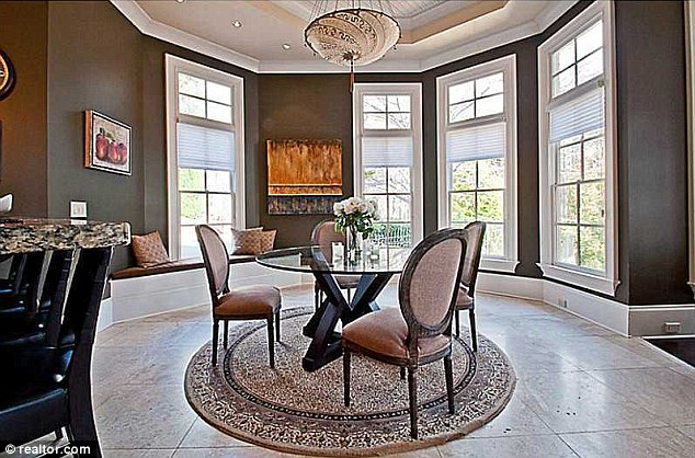 Dining area for four: Outside the kitchen area there is a glass table surrounded by stylish chairs