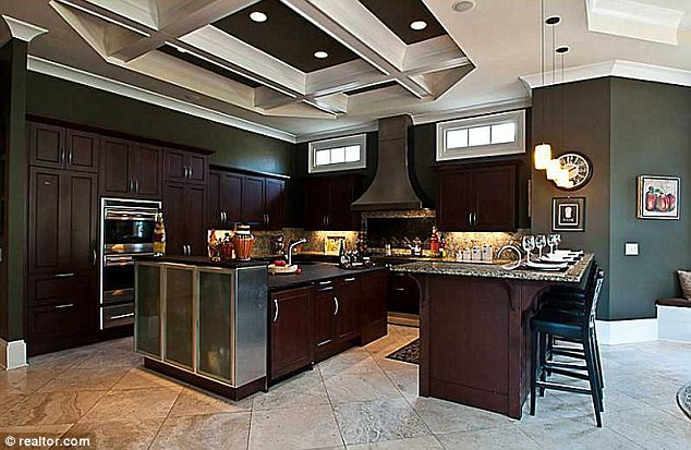 Breakfast is served... The kitchen is complete with a dining island and features stainless steel appliances