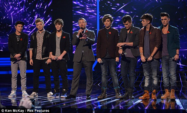 No hard feelings: District 3 faced Union J in Sunday night's sing off but claimed that there is no rivalry between the two of them
