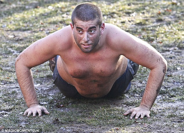 Gruelling: The TOWIE star seemed to be struggling to do his push-ups, and had mud smeared all over his face