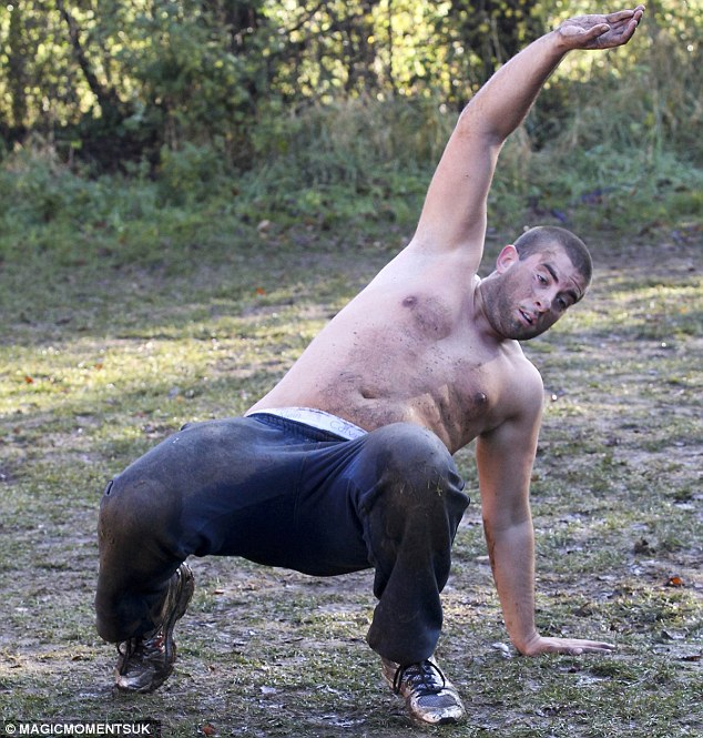 Giving it his all: Arg certainly seemed to be determined as he got involved in the gruelling workout